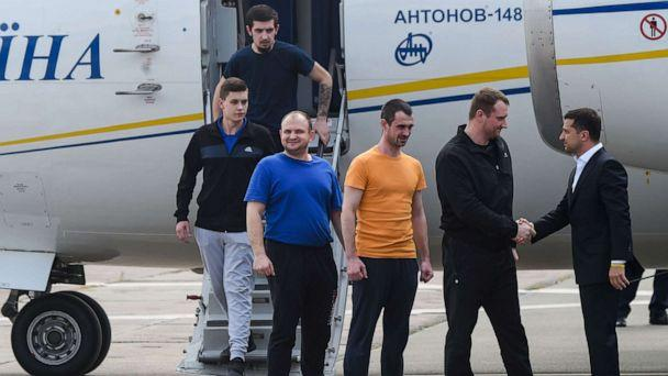 PHOTO: Ukraine's President Volodymyr Zelensky welcomes former prisoners as they disembark from a plane on September 7, 2019 at Boryspil international airport in Kiev after a long-awaited exchange of prisoners between Moscow and Kiev. (Sergei Supinsky/AFP/Getty Images)