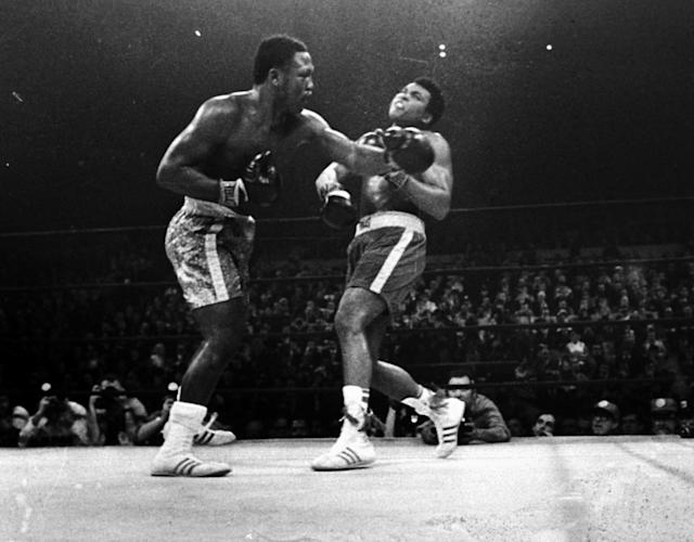 <p>Joe Frazier hits Muhammad Ali with a left during the 15th round of their heavyweight title fight at New York's Madison Square garden in this March 8, 1971 photo. (AP Photo) </p>