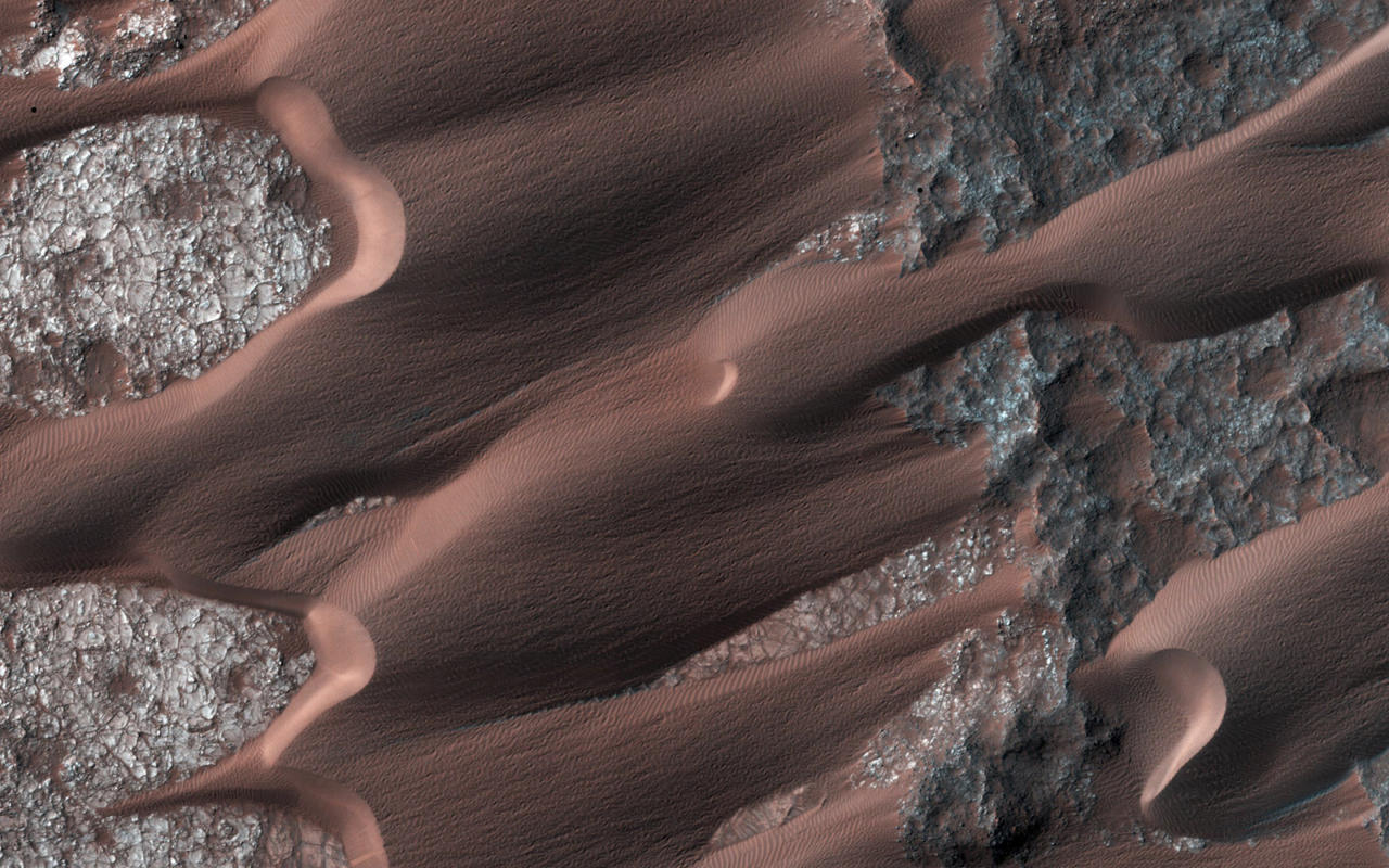 <p>Nili Patera, one of the most active dune fields on the planet Mars, is shown in this handout photo taken by NASA's Mars Reconnaissance Orbiter March 1, 2014. By monitoring the sand dune changes, NASA can determine how winds vary seasonally and year to year. (Photo: NASA/JPL-Caltech/Univ. of Arizona/Reuters) </p>