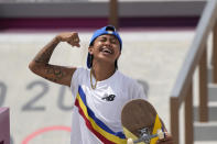 Margielyn Didal of Philippines reacts after completing a trick in the women's street skateboarding finals at the 2020 Summer Olympics, Monday, July 26, 2021, in Tokyo, Japan. (AP Photo/Ben Curtis)