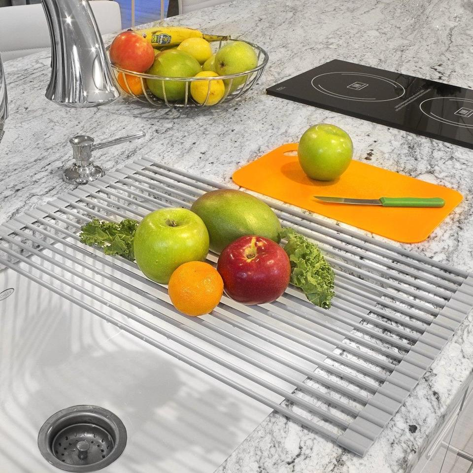 <p>This <span>Sorbus Roll-Up Dish Drying Rack </span> ($21) is ideal for drying dishes or washing and cutting produce.</p>