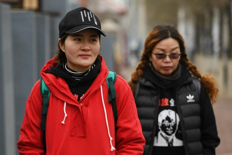 Li Wenzu (L), with supporter Lin Ermin, has had little news of her husband since he was detained in a police sweep nearly three years ago