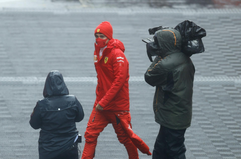 Ferrari driver Charles Leclerc of Monaco walks at the paddock during the second practice session for the Eifel Formula One Grand Prix at the Nuerburgring racetrack in Nuerburg, Germany, Friday, Oct. 9, 2020. The Germany F1 Grand Prix will be held on Sunday. (Ronald Wittek, Pool via AP)