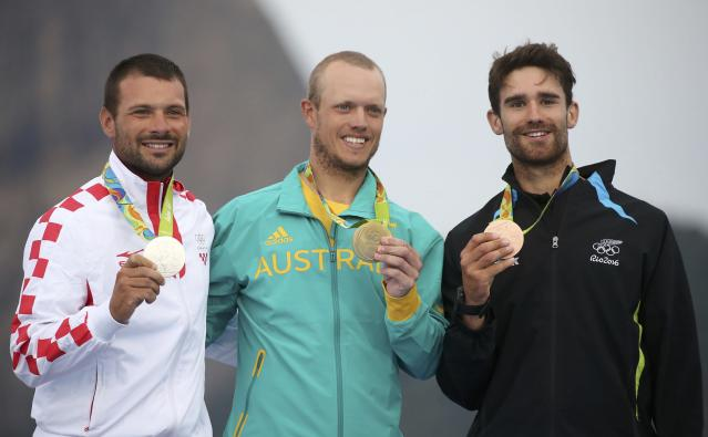 2016 Rio Olympics - Sailing - Victory Ceremony - Men's One Person Dinghy - Laser - Marina de Gloria - Rio de Janeiro, Brazil - 16/08/2016.Tonci Stipanovic (CRO) of Croatia,Tom Burton (AUS) of Australia and Sam Meech (NZL) of New Zealand pose with their medals. REUTERS/Benoit Tessier FOR EDITORIAL USE ONLY. NOT FOR SALE FOR MARKETING OR ADVERTISING CAMPAIGNS.