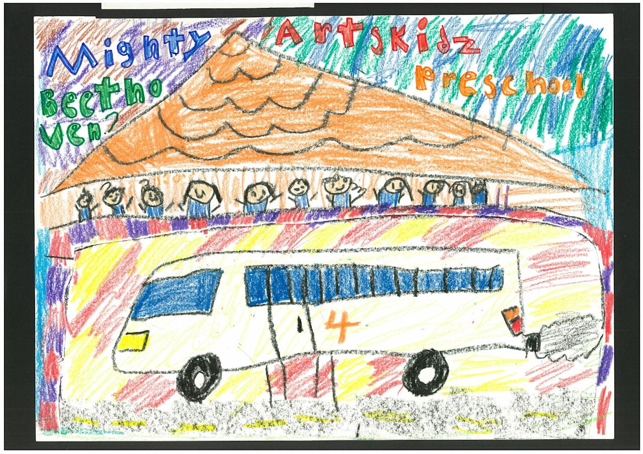 The bus ride to school with friends puts a smile on Kaito Ishitani's face. (Arts Kidz Preschool)