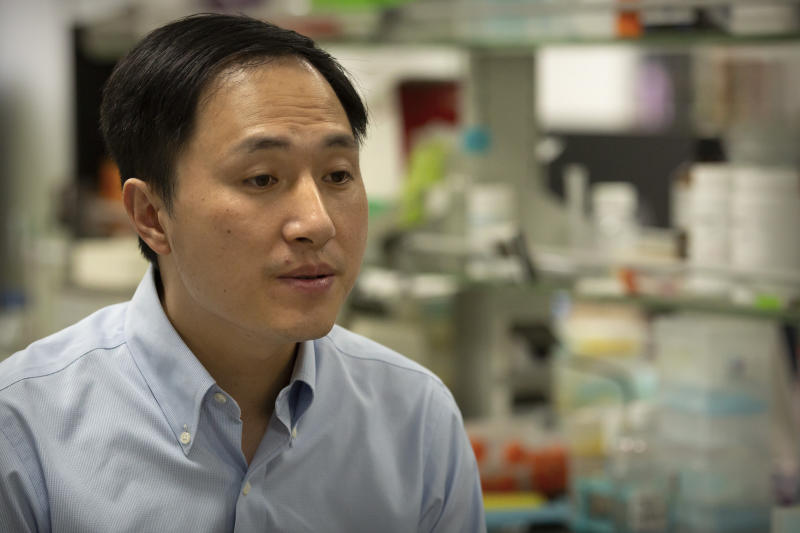 In this Oct. 10, 2018, photo, Chinese scientist He Jiankui speaks during an interview at his laboratory in Shenzhen in southern China's Guangdong province. Chinese state media says the researcher He has been sentenced to three years for practicing medicine illegally. He Jiankui was also fined 3 million yuan. Two others were also sentenced on the same charge. (AP Photo/Mark Schiefelbein)
