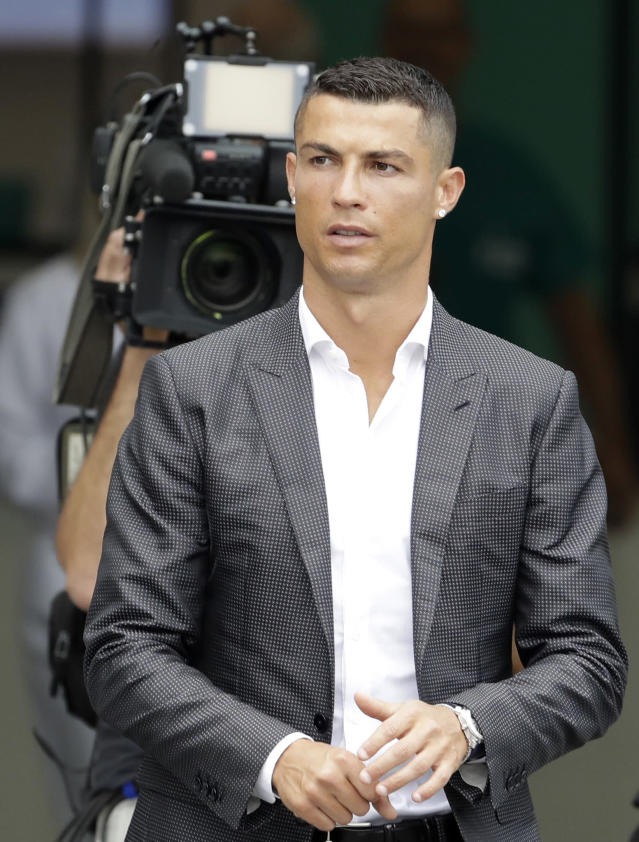 Portuguese ace Ronaldo arrives to undergo medical checks at the Juventus stadium in Turin, Italy, Monday, July 16, 2018. (AP Photo/Luca Bruno)