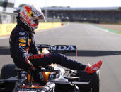 Red Bull driver Max Verstappen of the Netherlands leaves his car after finishing first in the Sprint Qualifying of the British Formula One Grand Prix, at the Silverstone circuit, in Silverstone, England, Saturday, July 17, 2021. The British Formula One Grand Prix will be held on Sunday. (Lars Baron/Pool via AP)