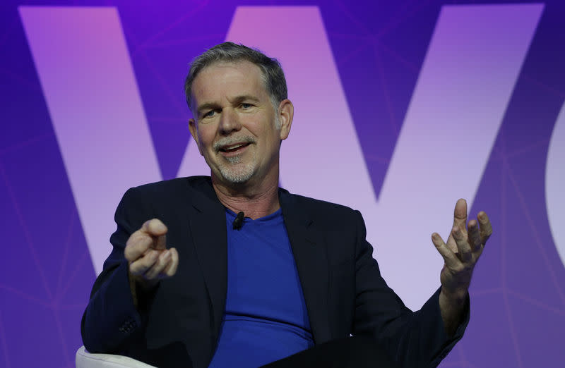 FILE PHOTO: Netflix's CEO Hastings gestures as he delivers his keynote speech during Mobile World Congress in Barcelona
