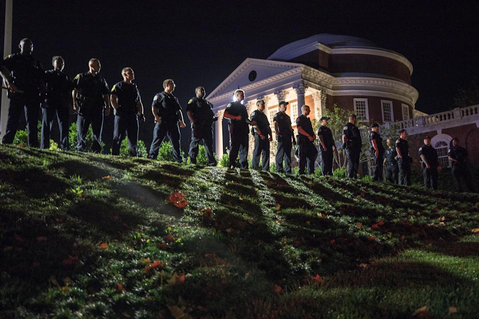 <p>Campus police at the University of Virginia following a march of hundreds of white nationalists and white supremacists carrying torches through the University of Virginia campus in Charlottesville, Va., on Aug. 11, 2017. (Photo: Evelyn Hockstein/For The Washington Post via Getty Images) </p>