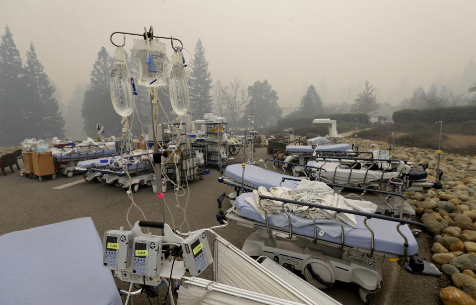 Hospital beds and other equipment sit in the parking lot outside the Feather River Hospital. (AP Photo/Rich Pedroncelli)