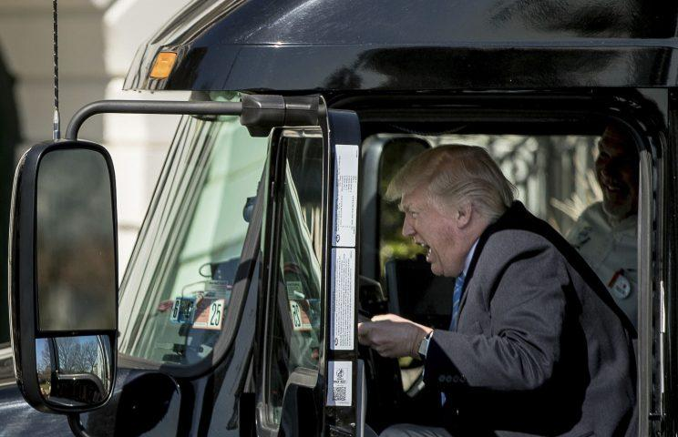 Donald Trump behind the wheel of a lorry (Rex)