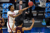 Alabama forward Herbert Jones (1) shoots over Iona forward Dwayne Koroma (11) in the first half of a first-round game in the NCAA men's college basketball tournament at Hinkle Fieldhouse in Indianapolis, Saturday, March 20, 2021. (AP Photo/Michael Conroy)