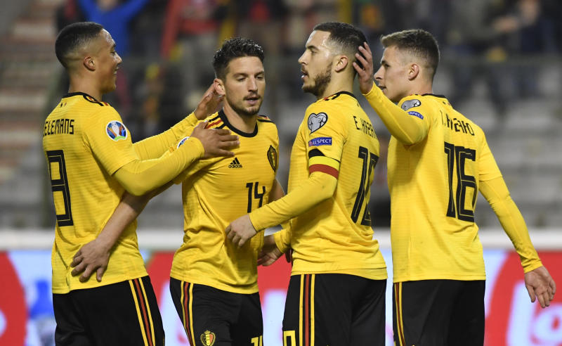Belgium's Eden Hazard, 2nd right, celebrates with teammates after scoring his sides second goal during the Euro 2020 Group I qualifying match between Belgium and Russia at the King Baudouin stadium in Brussels on Thursday March 21, 2019. (AP Photo/Geert Vanden Wijngaert)