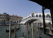 FILE - In this file photo dated Tuesday, March 27, 2018, a view of the Rialto bridge, in Venice, Italy. The recent devastating Notre Dame fire in Paris was a warning bell that all of Europe needs to hear, since so many monuments and palaces across the continent are in need of better upkeep according to European officials. National governments are increasingly looking for private donors to renovate major monuments prompting Diesel brand to back improvements for the Rialto bridge in Venice. (AP Photo/Luca Bruno)