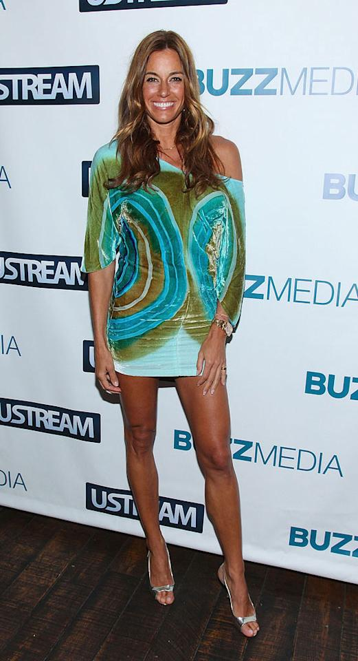 """Real Housewives of New York City"" star Kelly ""I Speak Gibberish and Never Wear Pants"" Bensimon treated the paparazzi to yet another overly-tanned, trouser-less look upon arriving at a Buzz Media bash in the Big Apple. Mike Coppola/<a href=""http://www.wireimage.com"" target=""new"">WireImage.com</a> - June 9, 2010"