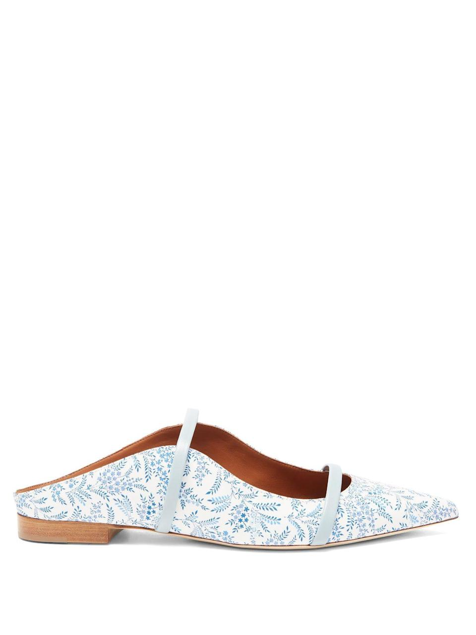 """<p><strong>MALONE SOULIERS</strong></p><p>matchesfashion.com</p><p><strong>$545.00</strong></p><p><a href=""""https://go.redirectingat.com?id=74968X1596630&url=https%3A%2F%2Fwww.matchesfashion.com%2Fus%2Fproducts%2FMalone-Souliers-Maureen-floral-print-backless-flats-1408251&sref=https%3A%2F%2Fwww.harpersbazaar.com%2Fwedding%2Fbridal-fashion%2Fg36113322%2Fwedding-flats-for-brides%2F"""" rel=""""nofollow noopener"""" target=""""_blank"""" data-ylk=""""slk:SHOP NOW"""" class=""""link rapid-noclick-resp"""">SHOP NOW</a></p><p>For a feminine take on a classic silhouette, opt for a flat mule in a dainty blue floral motif print—it works as your something blue, and pairs well with floral and ivory looks alike.</p>"""