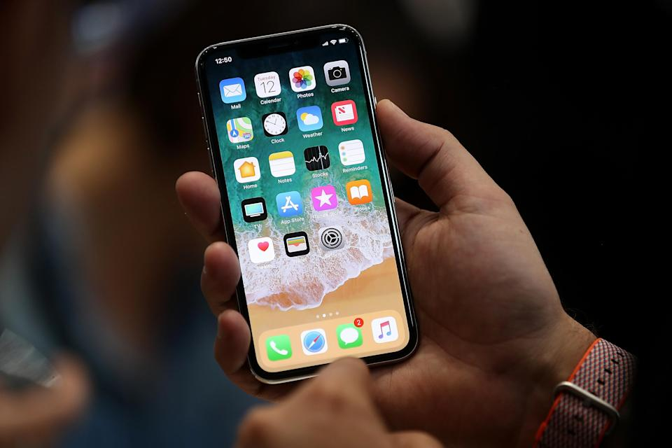 Want the latest iPhone X? Sign up for a deal to get £100 cashback. Getty Images
