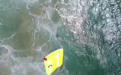 Two teenage boys sucked out to sea by a rip tide were saved from drowning by a drone, in what may be a world first - Credit: Caters News Agency