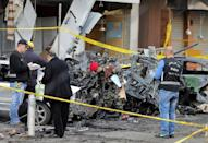 Lebanese forensic experts and Army soldiers inspect the site of a car bomb that targeted Beirut's southern suburb of Haret Hreik on January 3, 2014