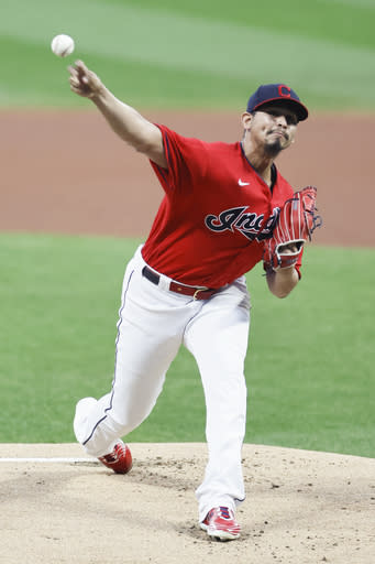 Cleveland Indians starting pitcher Carlos Carrasco delivers against the Pittsburgh Pirates during the first inning of a baseball game, Friday, Sept. 25, 2020, in Cleveland. (AP Photo/Ron Schwane)
