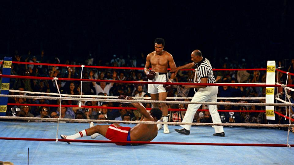 Mandatory Credit: Photo by Anonymous/AP/Shutterstock (7320084a)Muhammad Ali looks down at George Foreman during their bout in Kinshasa, ZaireAli Foreman Rumble In The Jungle 1974, Kinshasa, Zaire.