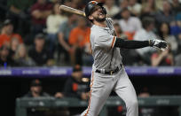 San Francisco Giants' Kris Bryant flies out against the Colorado Rockies in the fourth inning of a baseball game Friday, Sept. 24, 2021, in Denver. (AP Photo/David Zalubowski)