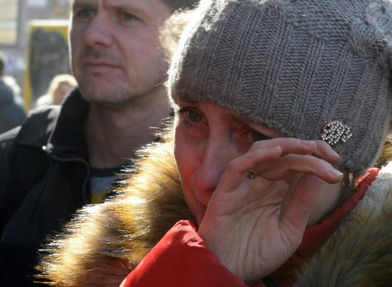 A woman reacts at a memorial site for the victims of the April 3 blast outside Technological Institute metro station in Saint Petersburg