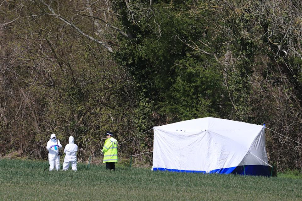 Police forensics investigators close to the scene in Snowdown, Kent, where the body of PCSO Julia James was found. Kent Police have launched a murder enquiry following the discovery of the 53-year-old community support officer on Tuesday. Picture date: Thursday April 29, 2021.