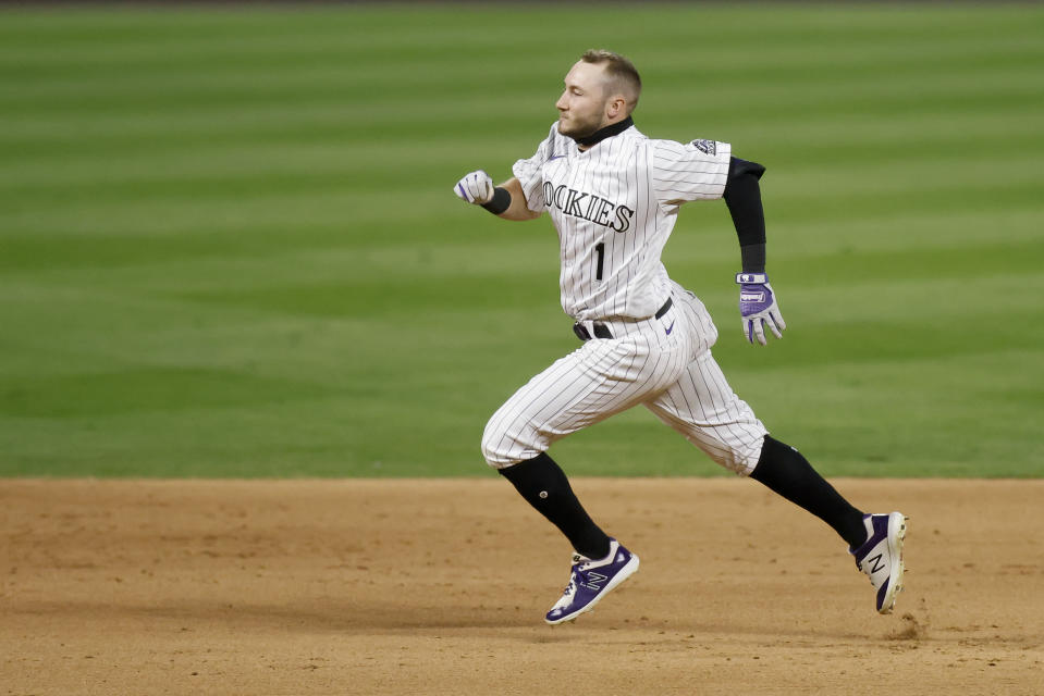 DENVER, CO - AUGUST 11: Garrett Hampson #1 of the Colorado Rockies sprints to third base on a triple in  the eighth inning against the Arizona Diamondbacks at Coors Field on August 11, 2020 in Denver, Colorado. (Photo by Justin Edmonds/Getty Images)