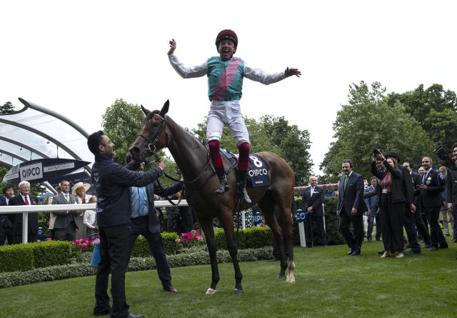 Frankie Dettori jumps from Enable after winning The King George VI and Queen Elizabeth Stakes during QIPCO King George Day at Ascot Racecourse.