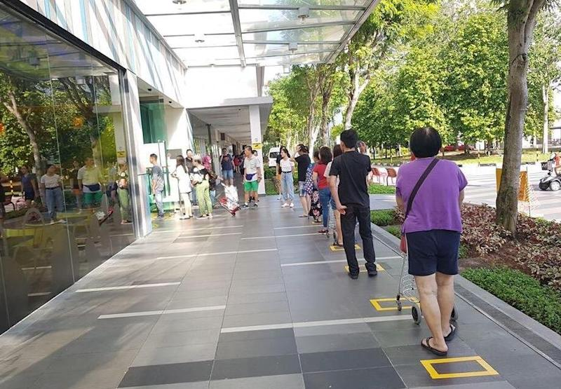 Demarcated squares for patrons to stand in queue for entry into YewTee Point on 27 March, 2020. (PHOTO: Arvie Castro)