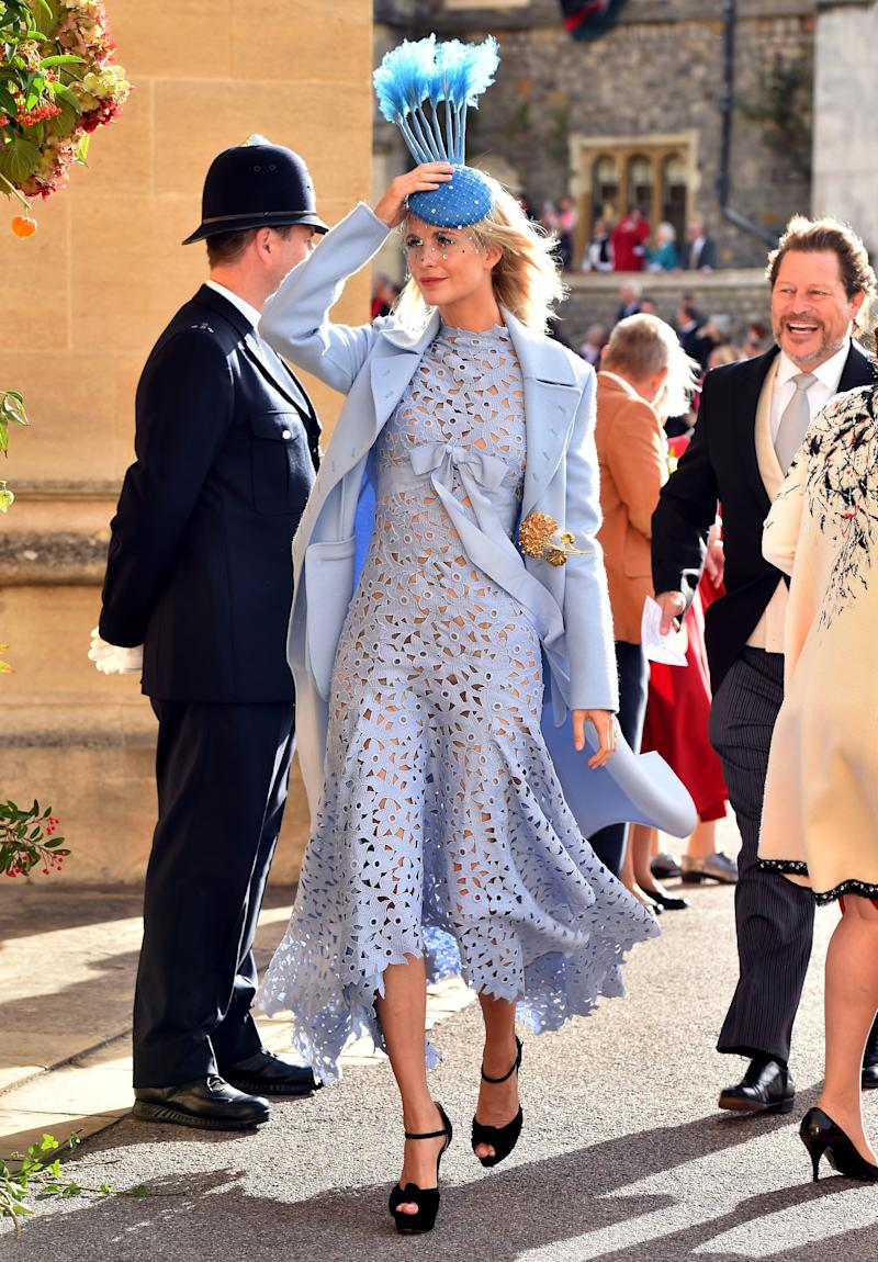 Poppy Delevingne arrives ahead of the wedding of Princess Eugenie of York and Mr. Jack Brooksbank at St. George's Chapel on October 12, 2018, in Windsor, England.
