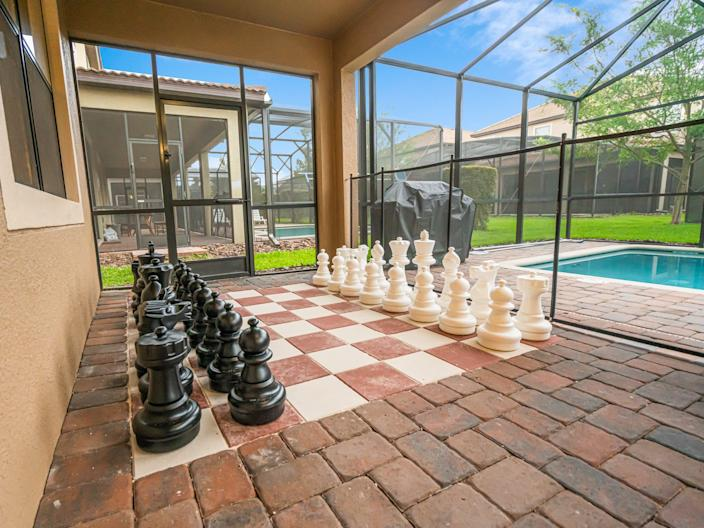 You can play chess or relax by the pool outside.