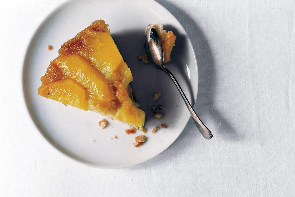 """Canned pineapple can be great, but when the fresh fruit is at its ripest, this classic cake is absolutely sublime. <a href=""""https://www.epicurious.com/recipes/food/views/fresh-pineapple-upside-down-cake-238072?mbid=synd_yahoo_rss"""" rel=""""nofollow noopener"""" target=""""_blank"""" data-ylk=""""slk:See recipe."""" class=""""link rapid-noclick-resp"""">See recipe.</a>"""