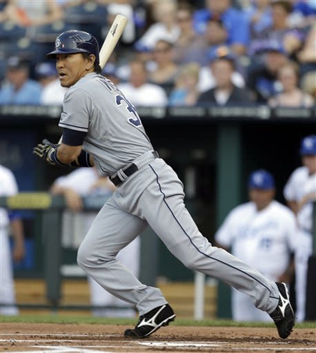 Tampa Bay Rays' Hideki Matsui hits into a double play during the first inning of a baseball game against the Kansas City Royals on Monday, June 25, 2012, in Kansas City, Mo. (AP Photo/Jeff Roberson)