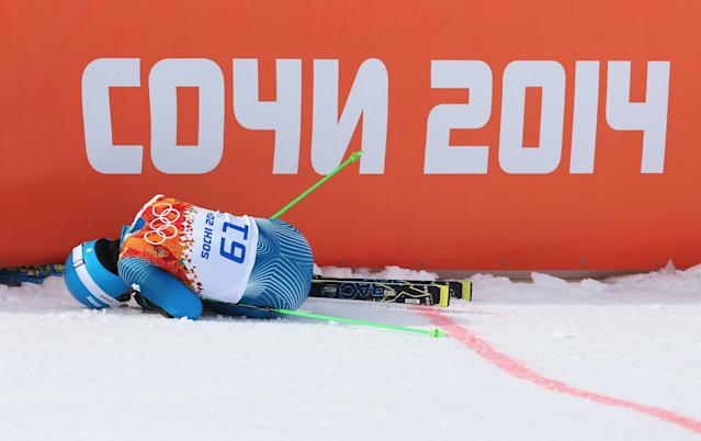 SOCHI, RUSSIA - FEBRUARY 19: Sung Hyun Kyung of Korea lies on the floor during the Alpine Skiing Men's Giant Slalom on day 12 of the Sochi 2014 Winter Olympics at Rosa Khutor Alpine Center on February 19, 2014 in Sochi, Russia. (Photo by Alexander Hassenstein/Getty Images)