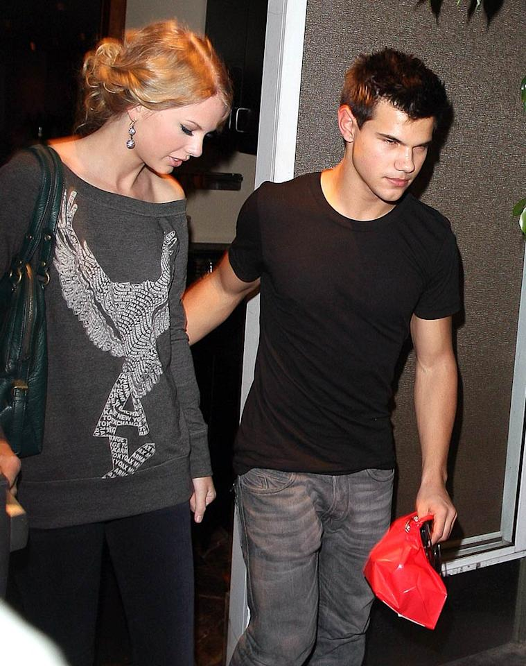 """Adam and Katy aren't dating (obviously) but it sure looks like Taylor Swift and Taylor Lautner are. The two Taylors went to a hockey game on Sunday, and then were spotted shopping and having dinner together on Wednesday. <a href=""""http://www.splashnewsonline.com"""" target=""""new"""">Splash News</a> - October 28, 2009"""