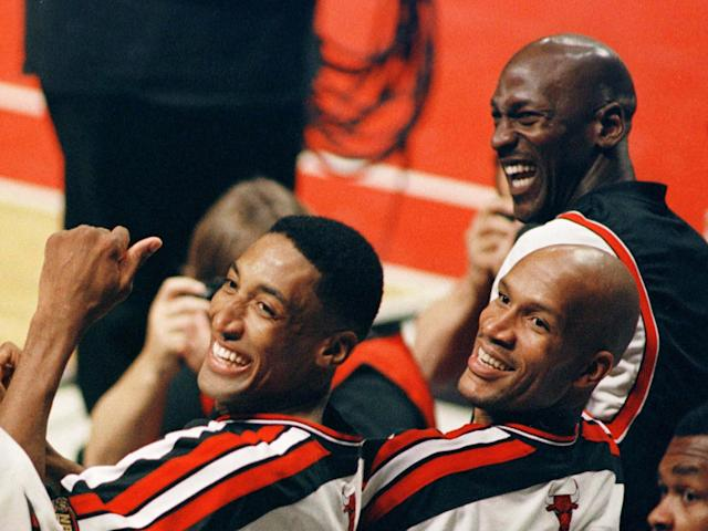 Ron Harper (center) with Scottie Pippen and Michael Jordan on the Chicago Bulls' bench.