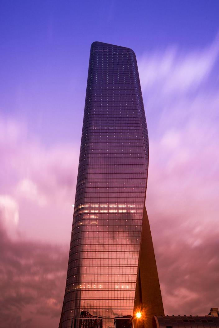 """<p><strong>Location:</strong> Kuwait City, Kuwait</p><p><strong>Height:</strong> 1,354 feet</p><p><strong>Completion Date:</strong> 2011</p><p>""""It looks quasi-impossible,"""" Safarik says. The Al Hamra Tower's draped curtain styling is intended to block out the Sun where its rays would fall most intensely, thus aiding in the passive cooling of a building that must endure Kuwait's sweltering climate.</p>"""