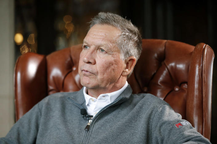 FILE - In a Dec. 13, 2018, file photo, then-Ohio Gov. John Kasich sits for an interview with The Associated Press in Columbus. Kasich, who ran against President Donald Trump in the 2016 Republican primary, says he supports impeachment. Kasich said Friday, Oct. 18, 2019, on CNN that the final straw was when acting White House chief of staff Mick Mulvaney acknowledged that Trump's decision to hold up military aid to Ukraine was linked to his demand that Kyiv investigate the Democratic National Committee and the 2016 U.S. presidential campaign. (AP Photo/John Minchillo, File)