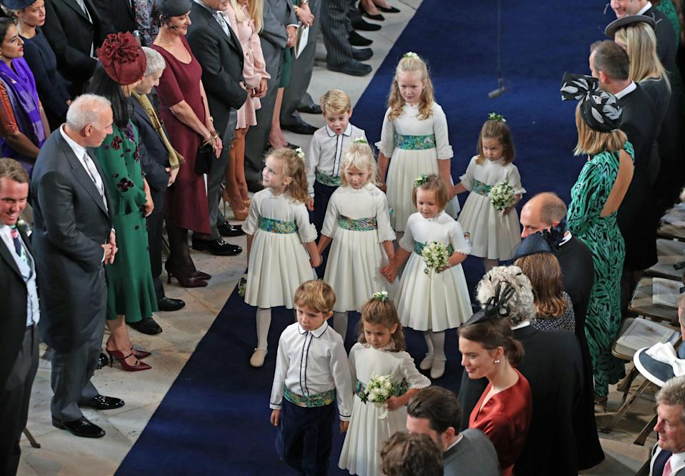 <p>The bridal party were given autumnal green sashes to offset their white outfits. Photo: Getty </p>