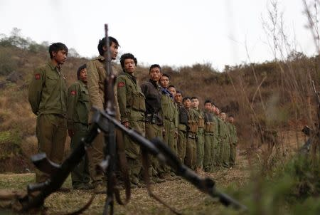 Rebel soldiers of Myanmar National Democratic Alliance Army (MNDAA) gather at a military base in Kokang region