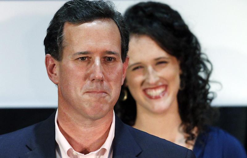 Republican presidential candidate, former Pennsylvania Sen. Rick Santorum, speaks as his daughter Elizabeth smiles at his primary election night rally in Gettysburg, Pa., Tuesday, March 20, 2012. (AP Photo/Charles Dharapak)