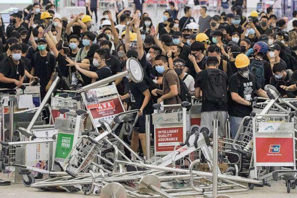 PHOTO: Demonstrators form a barricade as they clash with riot police at Hong Kong International Airport, Aug. 13, 2019. (Rick Findler/REX via Shutterstock)