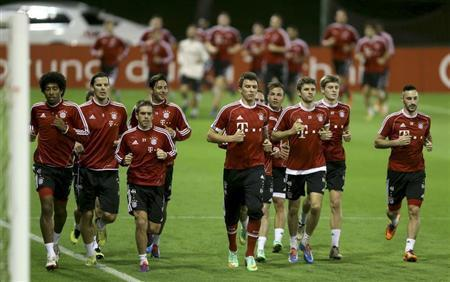 Bayern Munich's players participate in a training session at Aspire Academy for Sports Excellence in Doha January 5, 2014. REUTERS/Fadi Al-Assaad