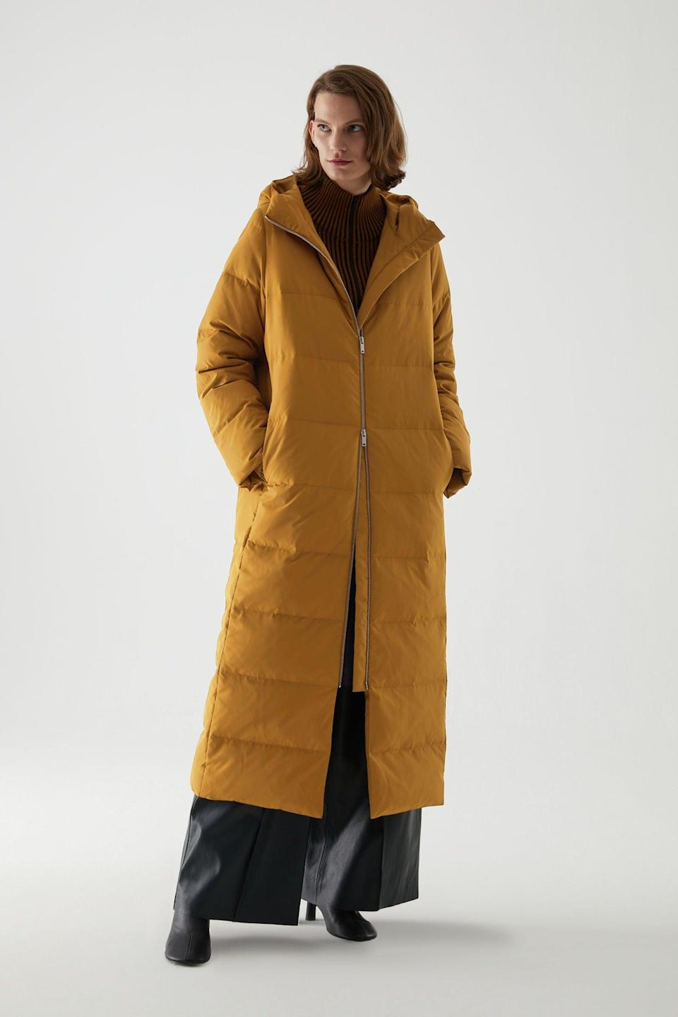 """<br><br><strong>COS</strong> Long Hooded Puffer Coat, $, available at <a href=""""https://www.cosstores.com/en_gbp/women/womenswear/coats-and-jackets/coats/product.long-hooded-puffer-coat-yellow.0916508002.html?"""" rel=""""nofollow noopener"""" target=""""_blank"""" data-ylk=""""slk:COS"""" class=""""link rapid-noclick-resp"""">COS</a>"""