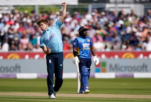 David Willey (left) celebrates after removing Charith Asalanka