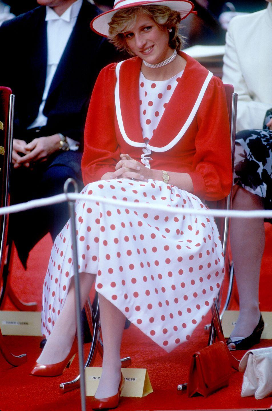 <p>Princess Diana wears a red polka dot ensemble at the opening of the Bourke Street Mall in Melbourne. </p>