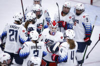 U.S. goalie Nicole Hensley, center, celebrates with teammates after a win over Japan in an IIHF women's hockey championships game in Calgary, Alberta Saturday, Aug. 28, 2021. (Jeff McIntosh/The Canadian Press via AP)